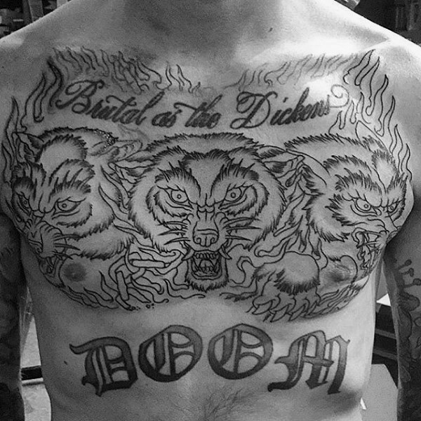 Old school style black and white chest and belly tattoo of Cerberus with lettering and flames