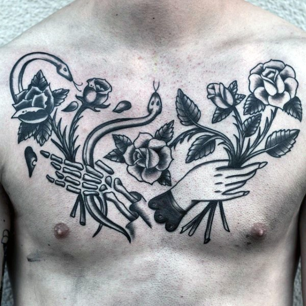 Old school style black ink chest tattoo of human and skeleton hands with flowers and snakes