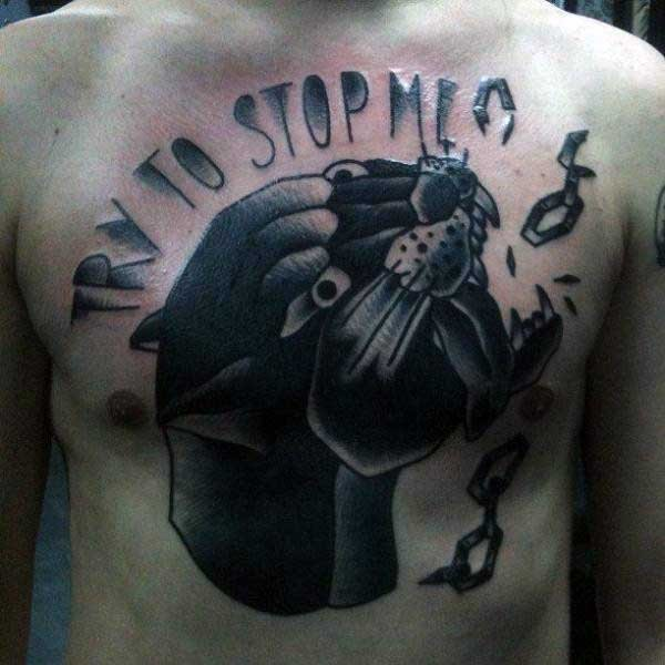 Old school style black ink chest tattoo of black panther with lettering and chain
