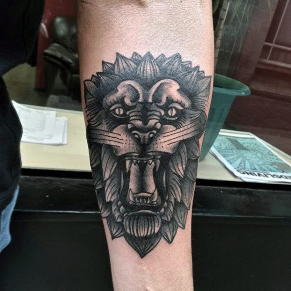 Old school style black ink forearm tattoo of lion statue
