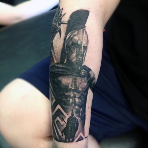 Old school style black ink Spartan warrior with dragon tattoo on arm