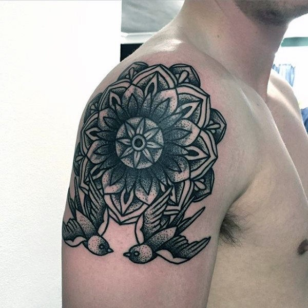 Old school style black ink upper arm tattoo of big flower with birds