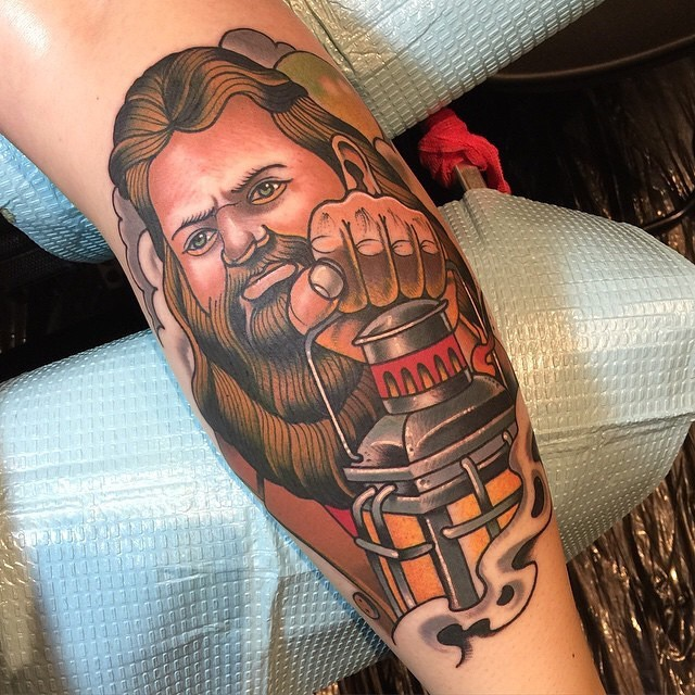 Old school style colored and detailed forearm tattoo of wizard with lighter
