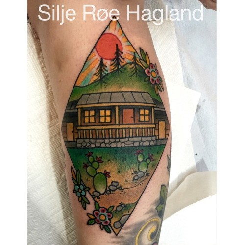 Old school style colored arm tattoo of picture with old house with sun