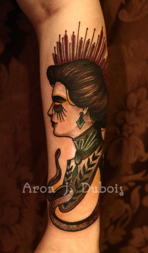 Old school style colored arm tattoo of creepy woman portrait