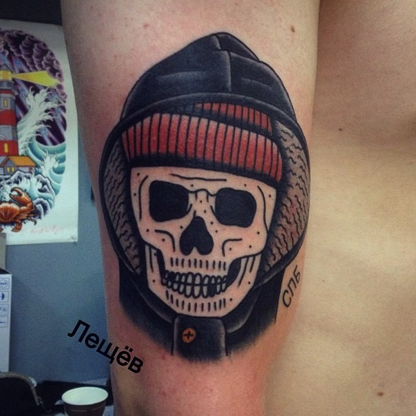 Old school style colored arm tattoo of skeleton with hood