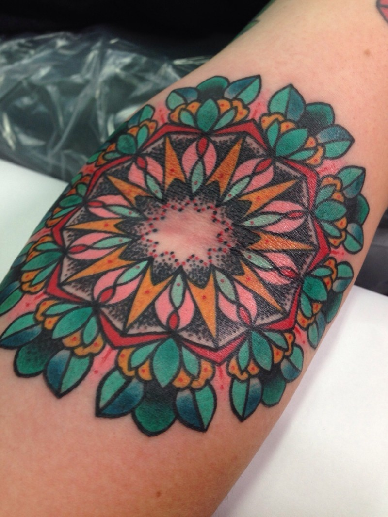 Old school style colored arm tattoo of ornamental flowers