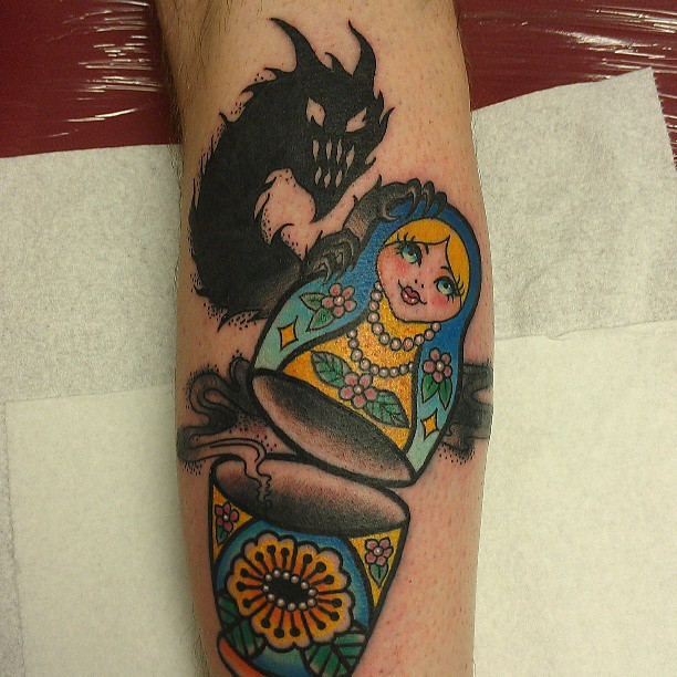 Old school style colored arm tattoo of Matryoshka doll with ghost