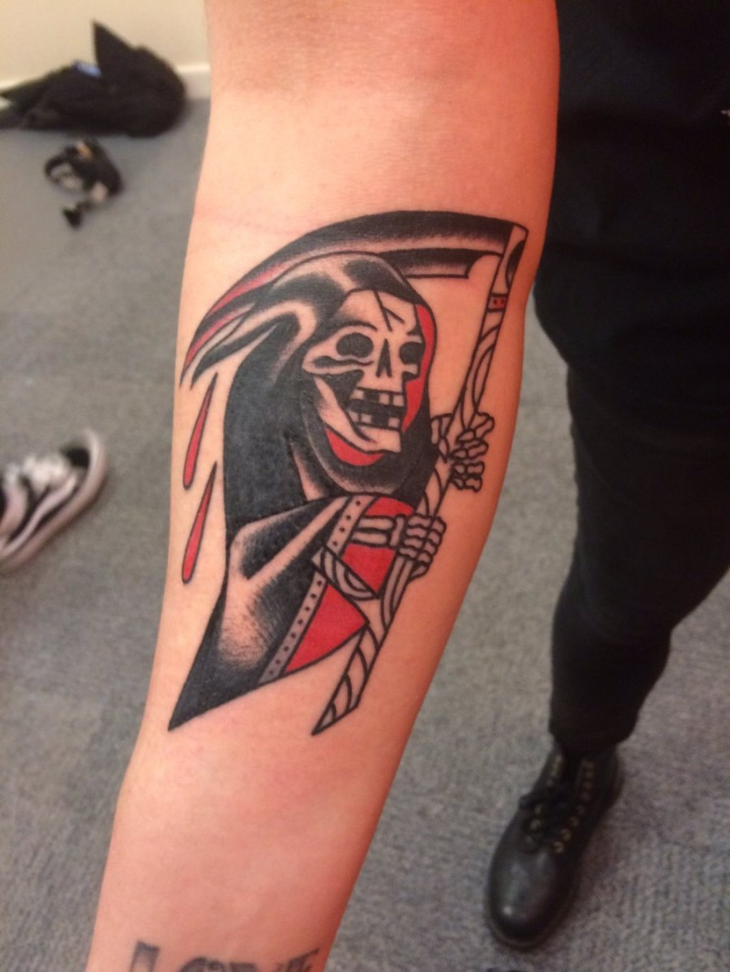 Old school style colored arm tattoo of Grimm reaper