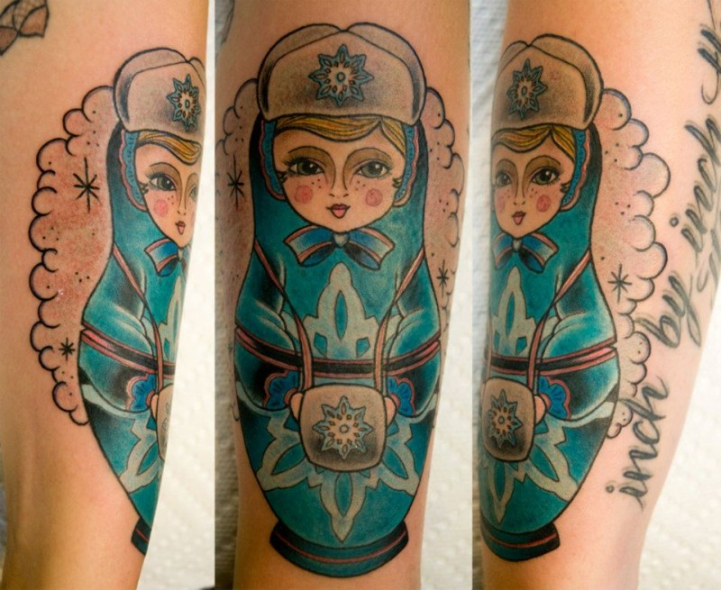 Old school style colored arm tattoo of Russian Matryoshka with lettering