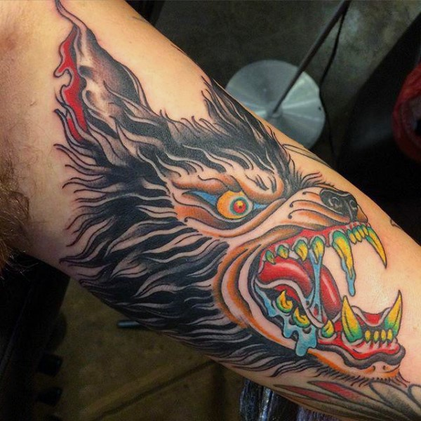Old school style colored arm tattoo of evil werewolf