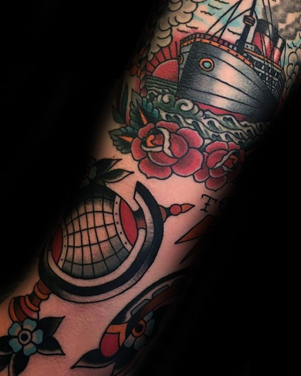 Old school style colored arm tattoo of big ship with rose and globe