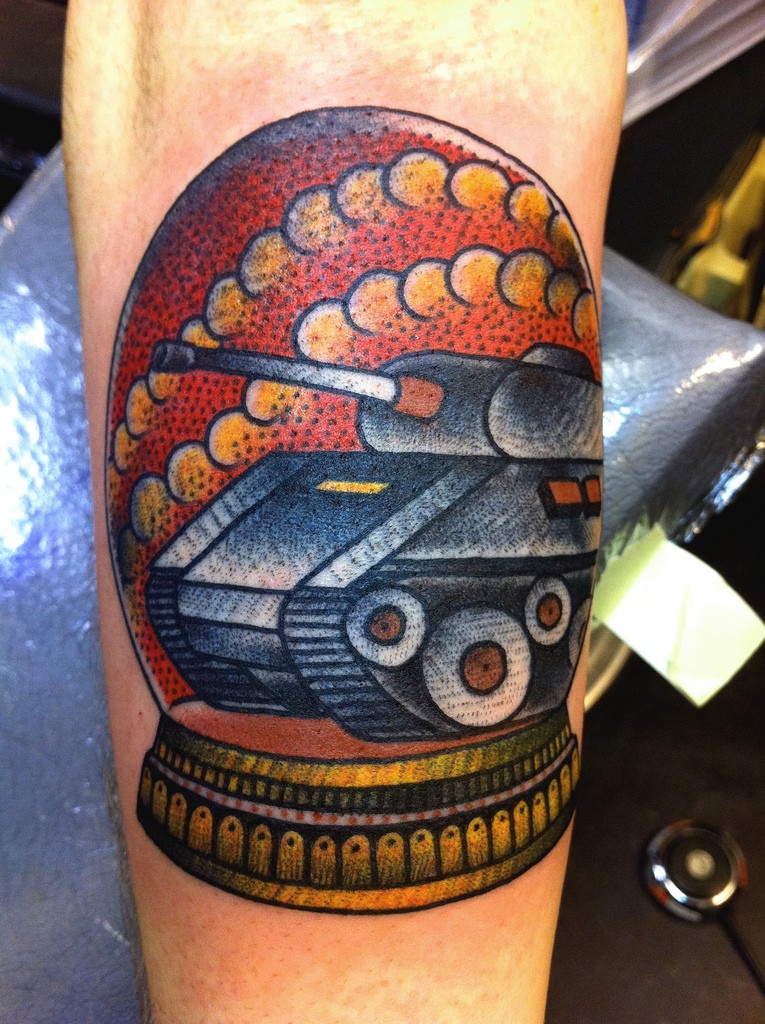 Old school style colored arm tattoo of vintage toy with tank