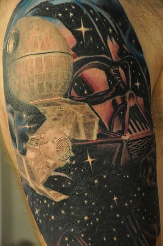 Old school style colored big space tattoo on shoulder with various empire star ships and Datrh Vader