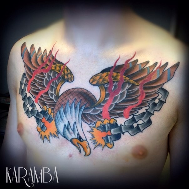Old school style colored chest tattoo of eagle with broken chain