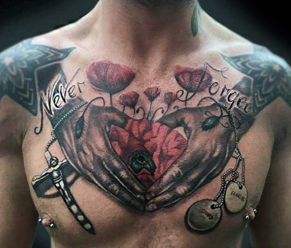 Old school style colored chest tattoo of human hands with flower, lettering and cross