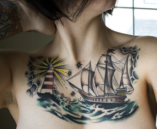 Old school style colored collarbone tattoo of sailing ship with lighthouse
