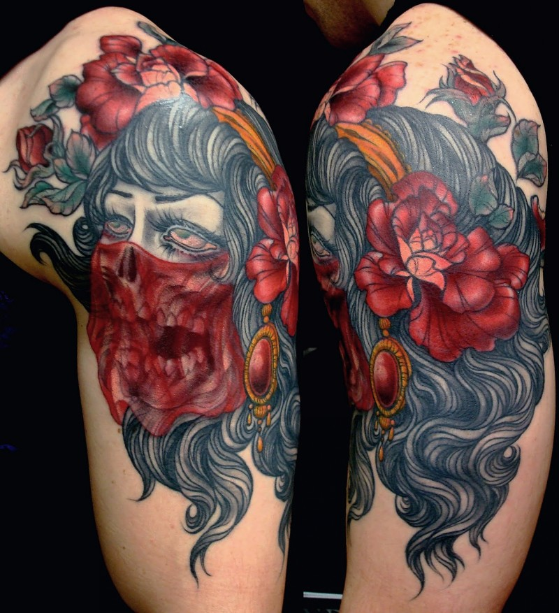 Old school style colored demonic shoulder tattoo of skull like woman with flowers