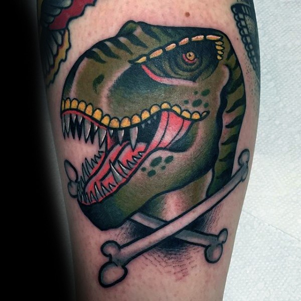 Old school style colored dinosaur head with crossed bones