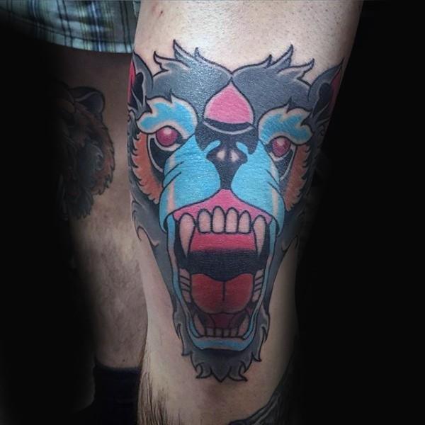 Old school style colored evil monkey head tattoo on knee