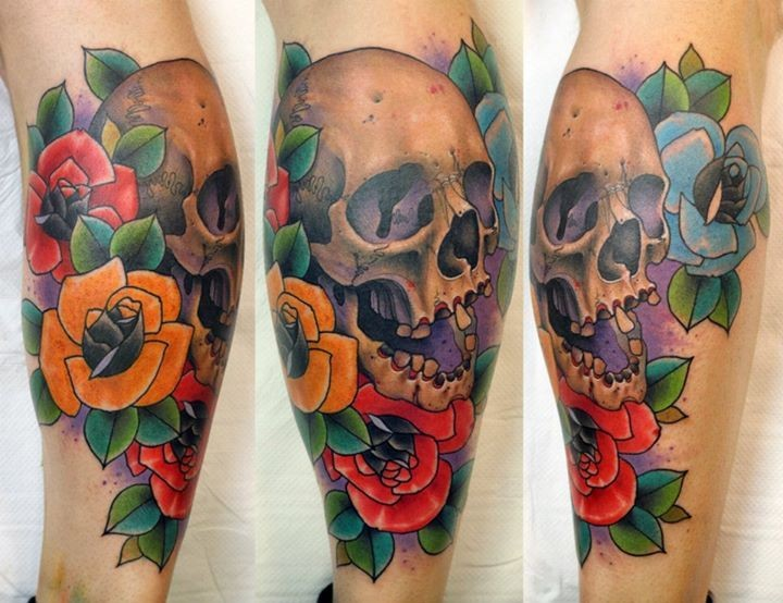 Old school style colored flowers tattoo on leg combined with human skull