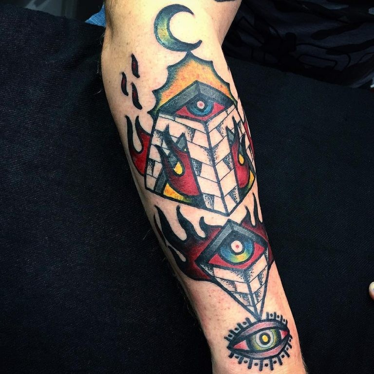 Old school style colored forearm tattoo of mystical pyramid pars with eyes