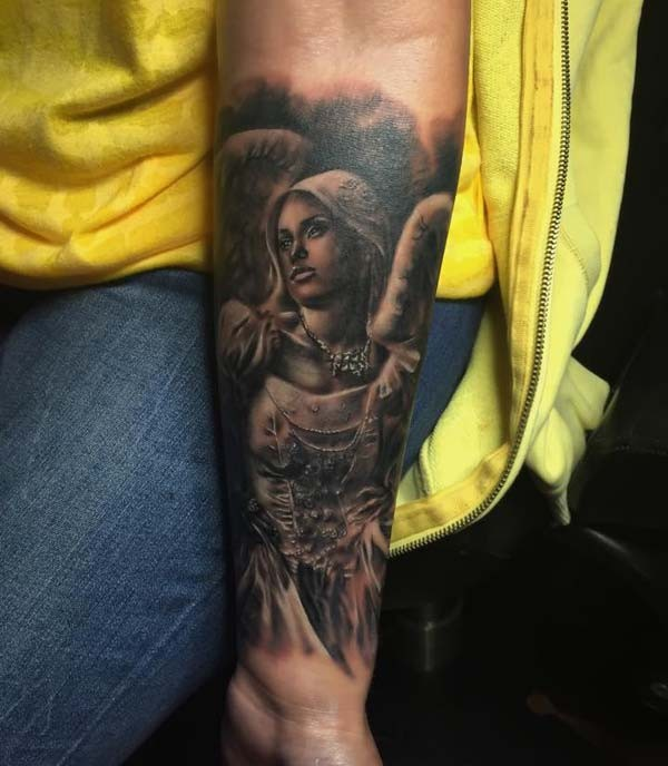 Old school style colored forearm tattoo of angel woman