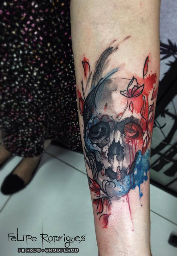 Old school style colored forearm tattoo of human skull with flowers