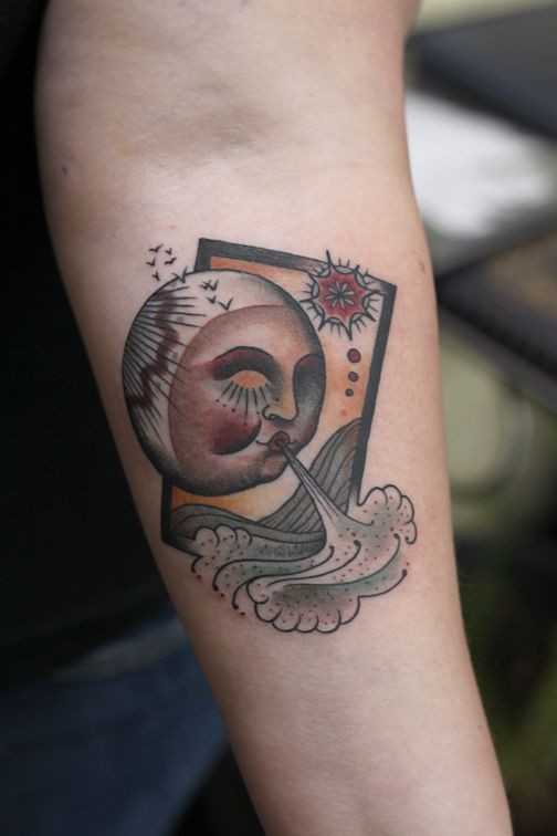 Old school style colored forearm tattoo of interesting looking picture with moon and waves