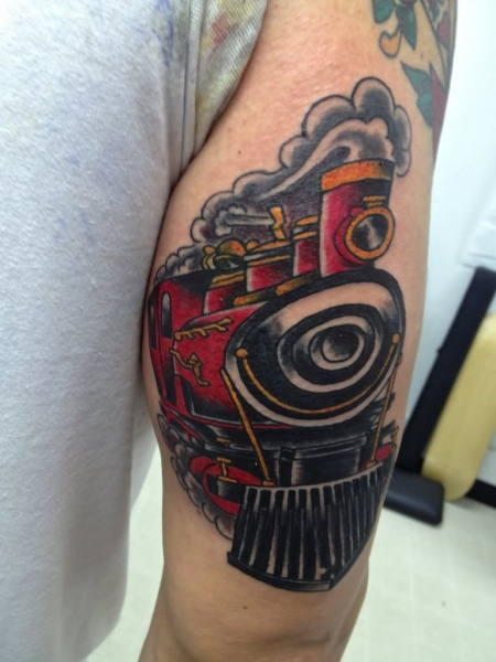 Old school style colored forearm tattoo of vintage train