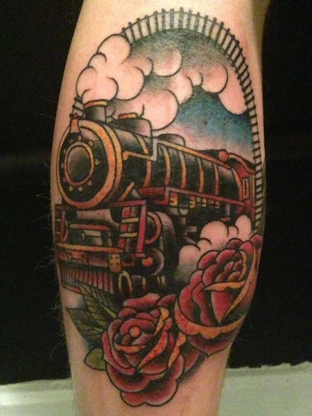 Old school style colored framed steaming train tattoo with red roses