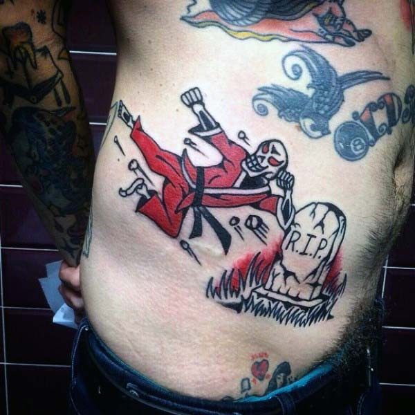 Old school style colored funny skeleton fighter with tomb stone tattoo on side