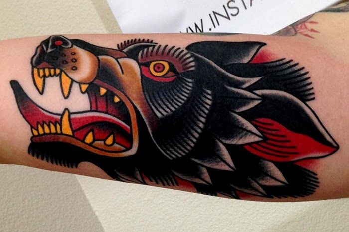 Old school style colored furious crazy wolf&quots head tattoo on arm