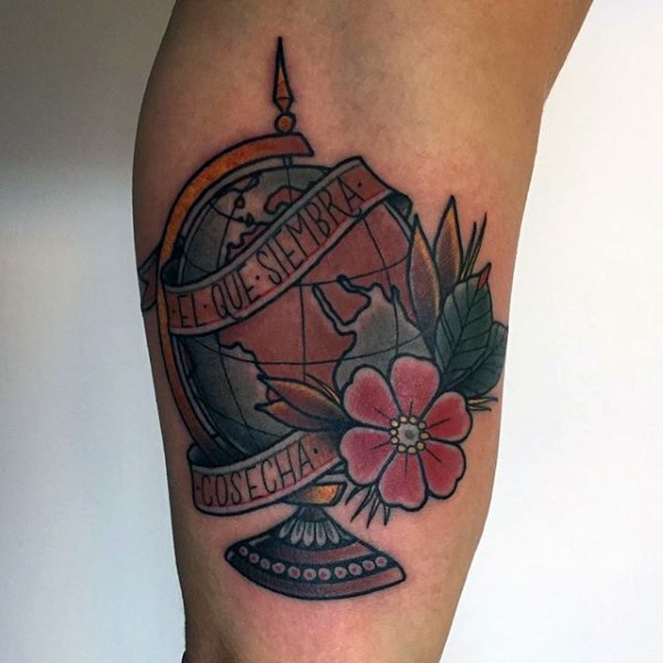 Old school style colored globe with flowers tattoo combined with lettering