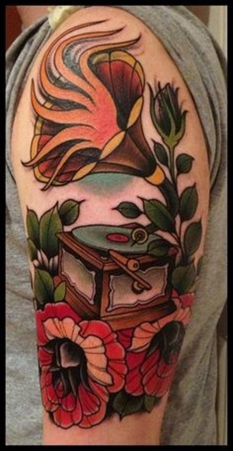 Old school style colored gramophone tattoo on shoulder with flowers and flames