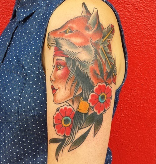 Old school style colored gypsy woman with fox helmet tattoo on shoulder stylized with flowers