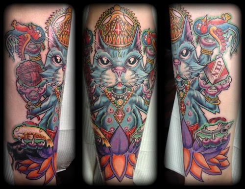 Old school style colored Hinduism like cat tattoo on forearm with lotus flower