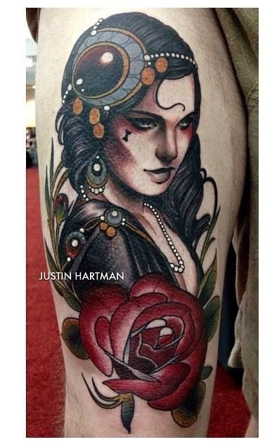 Old school style colored h=thigh tattoo of mystical gypsy woman with flowers
