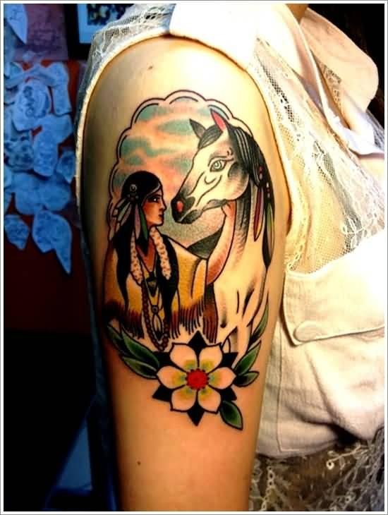 Old school style colored Indian woman with horse portrait tattoo on shoulder combined with flower