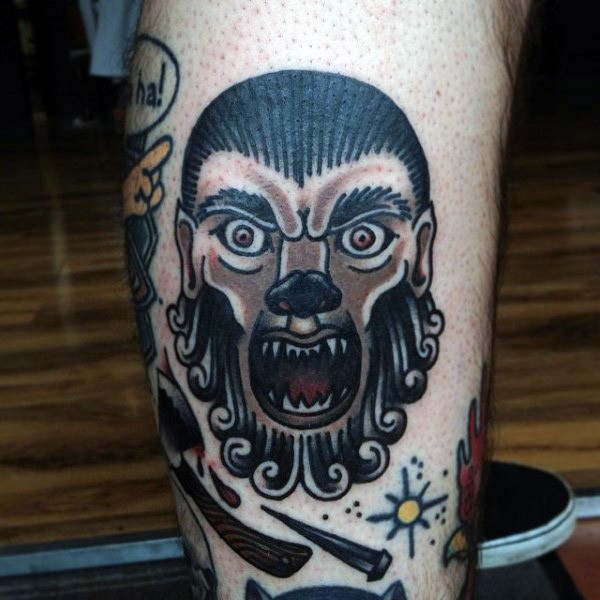 Old school style colored leg tattoo of werewolf face