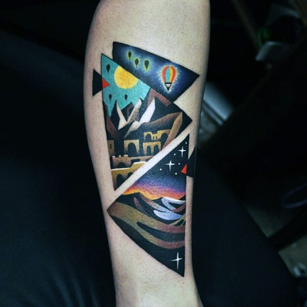 Old school style colored leg tattoo of triangles with various pictures