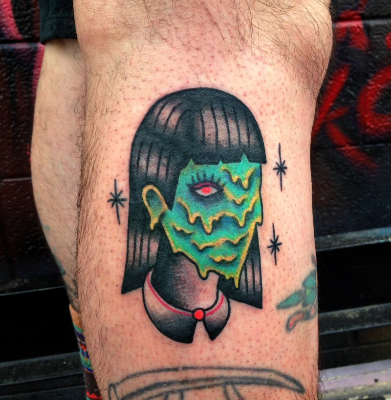 Old school style colored leg tattoo of monster woman face