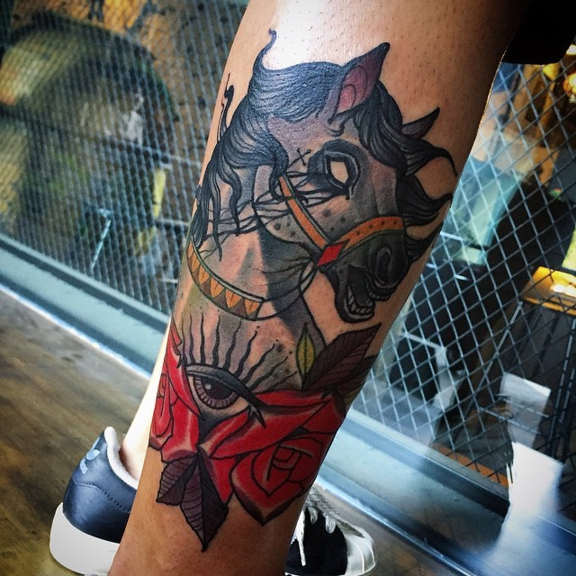 Old school style colored leg tattoo of horse with eye and rose