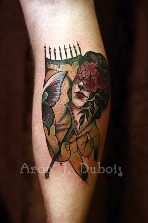 Old school style colored leg tattoo of woman with flowers