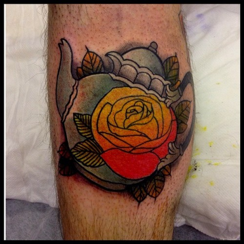 Old school style colored leg tattoo of tea pot with flower