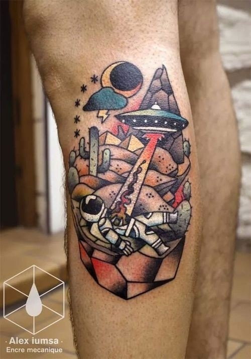 Old school style colored leg tattoo of alien ship with astronaut in desert