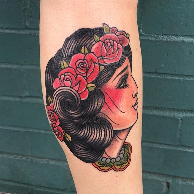 Old school style colored leg tattoo of gypsy woman with flowers