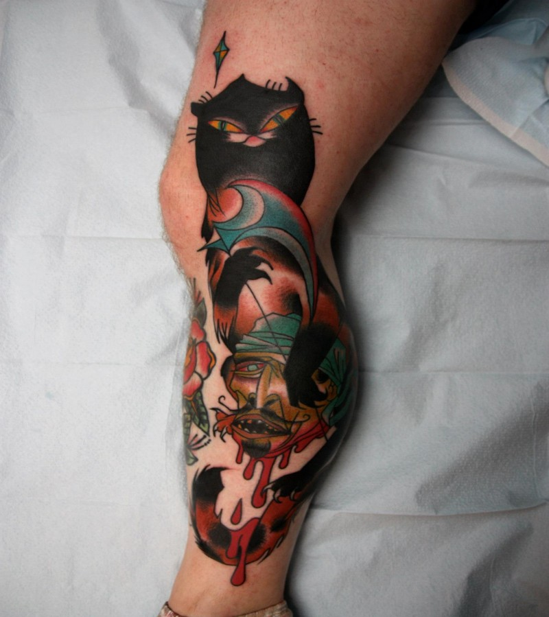 Old school style colored leg tattoo of of bloody human head with creepy cat