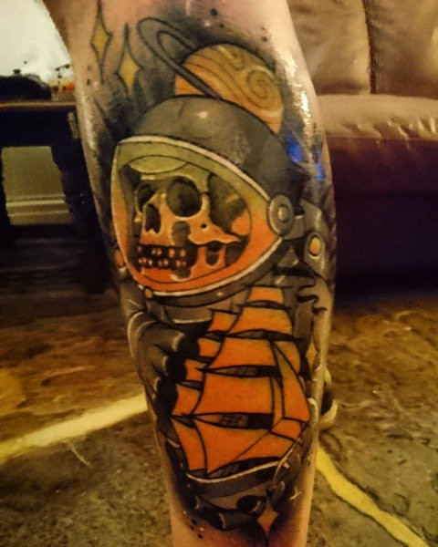 Old school style colored leg tattoo of of astronaut with sailing ship