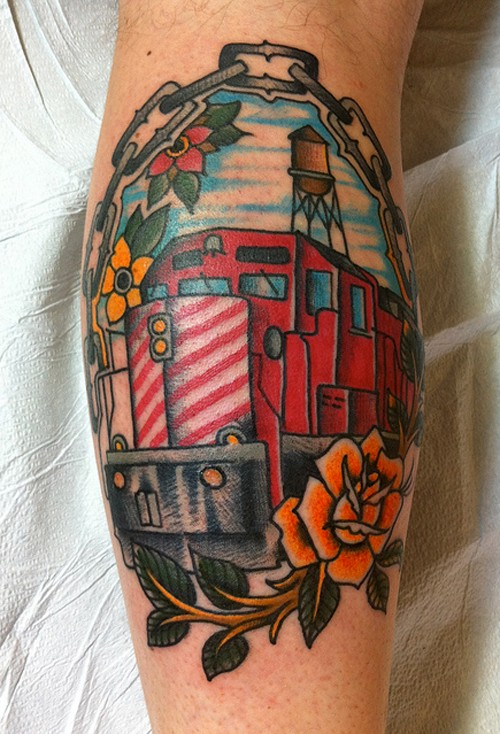 Old school style colored leg tattoo of modern big train with chain and flower